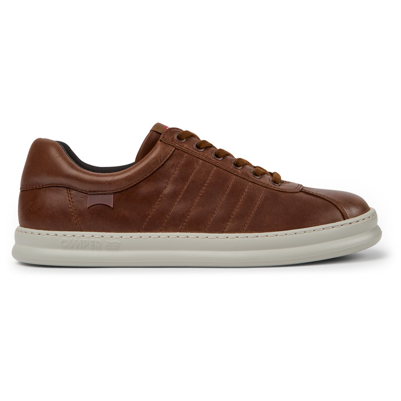 Camper Runner, Sneakers Men, Brown , Size 6 (US), K100227-014 - Upper: Leather (Calfskin) Color: Brown Outsole/Features: EVA for lightweight XLEXTRALIGHT for lightness and shock absorption 360 stitched for durability Insole: OrthoLite for cushioning Lining: 51% Fabric (100% Recycled PET) 26% Fabric (60% Nylon - 40% PU) 23% Polyester Leather Working Group Certified - Brown mens sneaker. Full-grain leather and EVA outsole. Our Runner mens sneakers offer a relaxed look with soft leather and a sporty silhouette in a reimagined style taken from our archives.