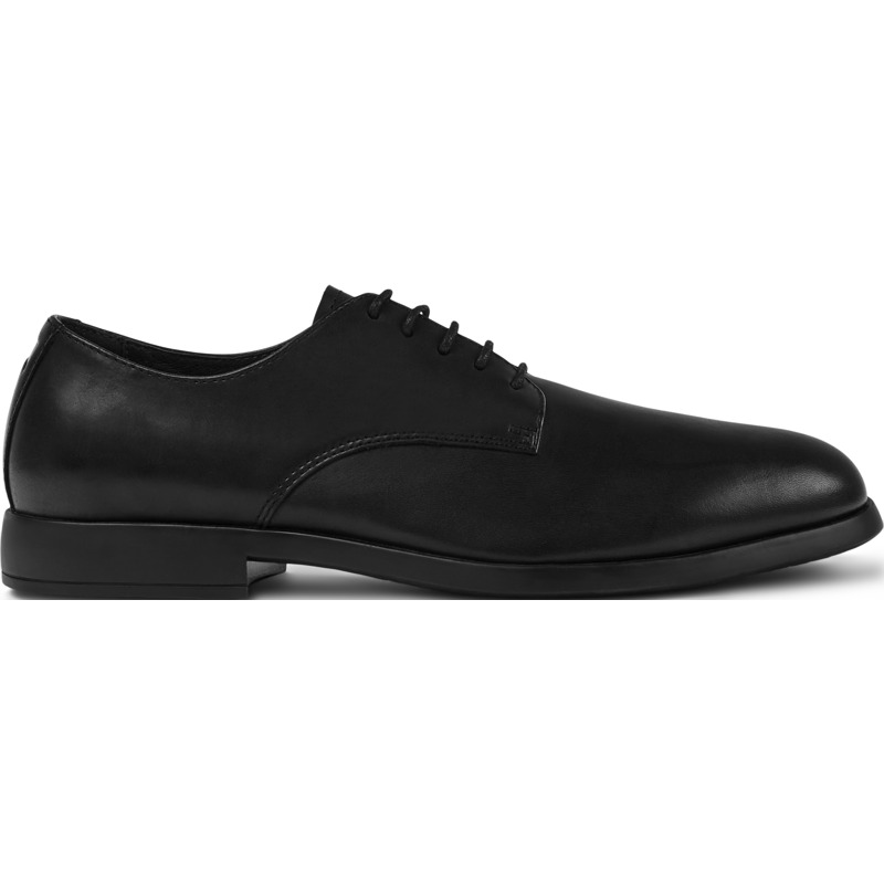 Camper Truman, Formal shoes Men, Black , Size 6 (US), K100243-001 - Upper: Leather (Calfskin) Color: Black Outsole/Features: Rubber for good grip Lining: 45% Pigskin 33% Cotton 22% Fabric (60% Nylon - 40% PU) Leather Working Group Certified - Black shoe for men. Full-grain leather and rubber utsole. Inspired by a traditional English typology, our Truman men\\\'s shoes are a smart style that combines a classic look with surprising flexibility and a subtle splash of color.