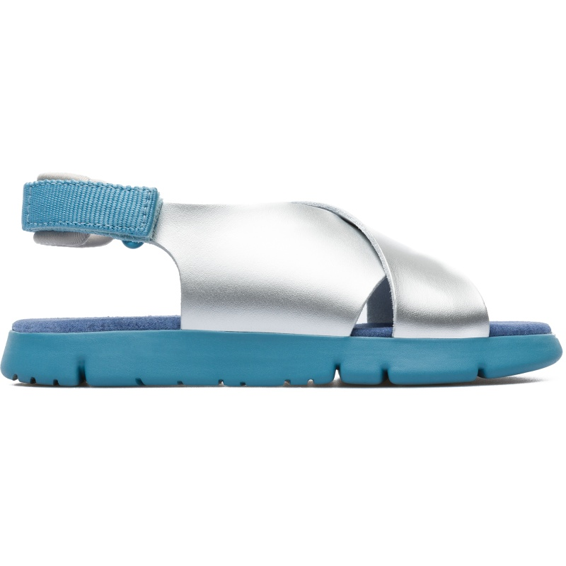 Camper Oruga, Sandals Kids, Grey , Size 25 (US), K800163-002 - Smooth satin leather Color: silver, gray and blue Lightweight. Outsole: EVA Ultra lightweight with great thermal insulation properties. Lining: 60 % Fabric (60% Nylon - 40% PU) 40 % Calfskin - Our Mira girls\\\' sandals feature colorful, adjustable straps and a lightweight outsole, offering a sporty summer option for active kids.