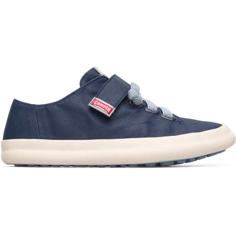 Camper Pursuit, Sneakers Kids, Blue , Size 25 (US), K800235-001 - Main material: Cotton fabric Color: navy Velcro Ortholite in footbed: cushioning and moisture management Lining: 84 % Cotton 16 % Fabric (60% Nylon - 40% PU) - These boys Velcro sneakers have a clean, contemporary look and provide the perfect platform for those early steps. The uppers are put together with a Strobel construction technique that makes the shoes flexible. Vulcanisation adds protection and flexibility, while the grippy rubber outsoles prevent slips. The interiors have cotton linings for better breathability and the footbeds contain OrthoLite which cushions the feet and keeps them dry.