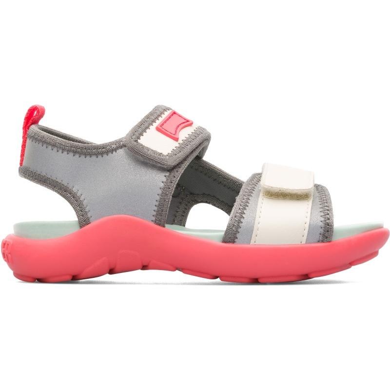 Camper Wous, Sandals Kids, Grey/Beige, Size 25 (US), K800238-003 - Main material: Reflective fabric with elastic textile base Color: cream / reflective Velcro Lining: 53 % PU 44 % Nylon 3 % Fabric (60% Nylon - 40% PU) - Contemporary style and well-thought-out details make these boys sporty sandals a contender for our best kids shoes ever. Designed for use on land and in water and perfect for active children, these are both highly flexible and extra lightweight. They have adjustable Velcro straps for an easy fit and are made from easy-to-clean nylon. Their rubber outsoles offer enhanced grip to prevent slips and an anatomic PU footbed helps to cushion the feet.