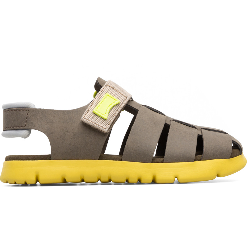Camper Oruga, Sandals Kids, Grey , Size 25 (US), K800242-005 - Upper: Leather (Calfskin) / Technical fabric (Nylon) Color: Beige Outsole/Features: EVA with flex-cuts and extraordinary light Velcro closing system for easy fit Insole: Padded for cushioning Lining: 52% Calfskin 38% Fabric (60% Nylon - 40% PU) 7% Fabric (60% Polyester - 35% Nylon - 5% Spandex) 3% Fabric Leather Working Group Certified - Beige T-strap sandal for kids. Full-grain leather and EVA outsole with flex-cuts. The light and bendable Oruga combines Camper\\\'s distinctive urban style with soft leathers and textiles.