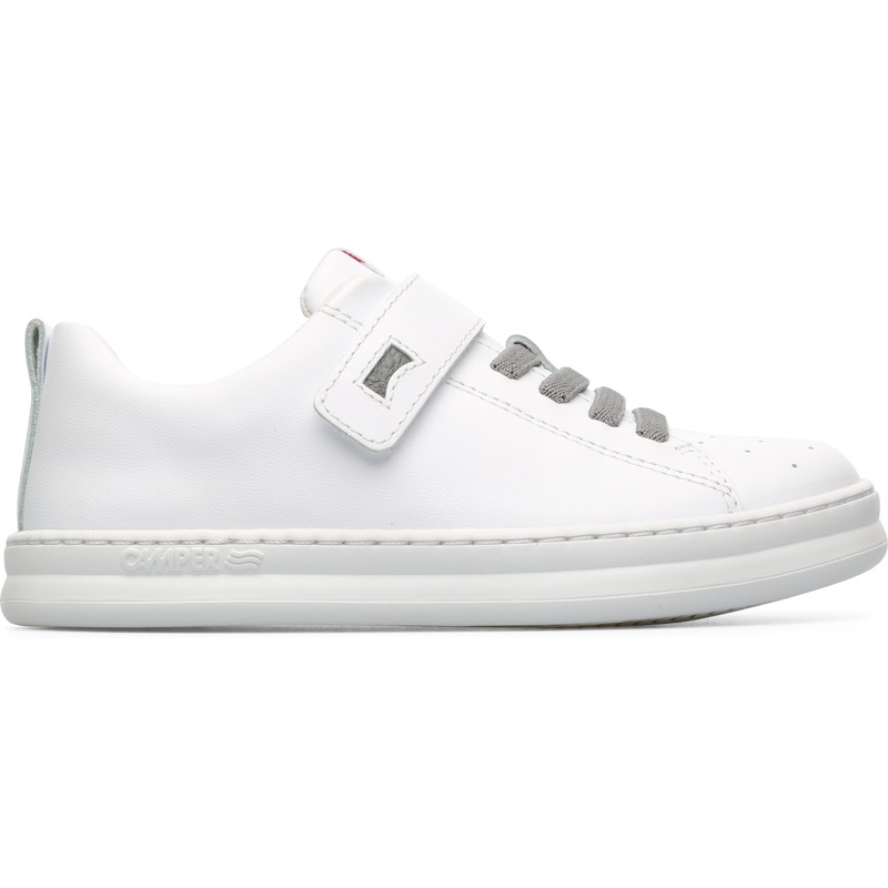 Camper Runner, Sneakers Kids, White , Size 25 (US), K800247-002 - Main material: Smooth leather Color: white Leather Working Group Certified Velcro Ortholite in footbed: cushioning and moisture management Lining: 67 % Fabric (60% Nylon - 40% PU) 33 % Polyester - These boys white sneakers have a classic and refined style. Highly functional and perfect for active boys, these are lightweight and flexible thanks to a unique Strobel construction technique. The sporty shoes have rubber cupsoles that offer better grip to prevent slipping and are stitched 360 for better durability. They have rubber on the toes for protection and breathable OrthoLite footbeds to help keep the feet dry and comfortable. To ensure the perfect fit, they have both laces and Velcro fasteners.