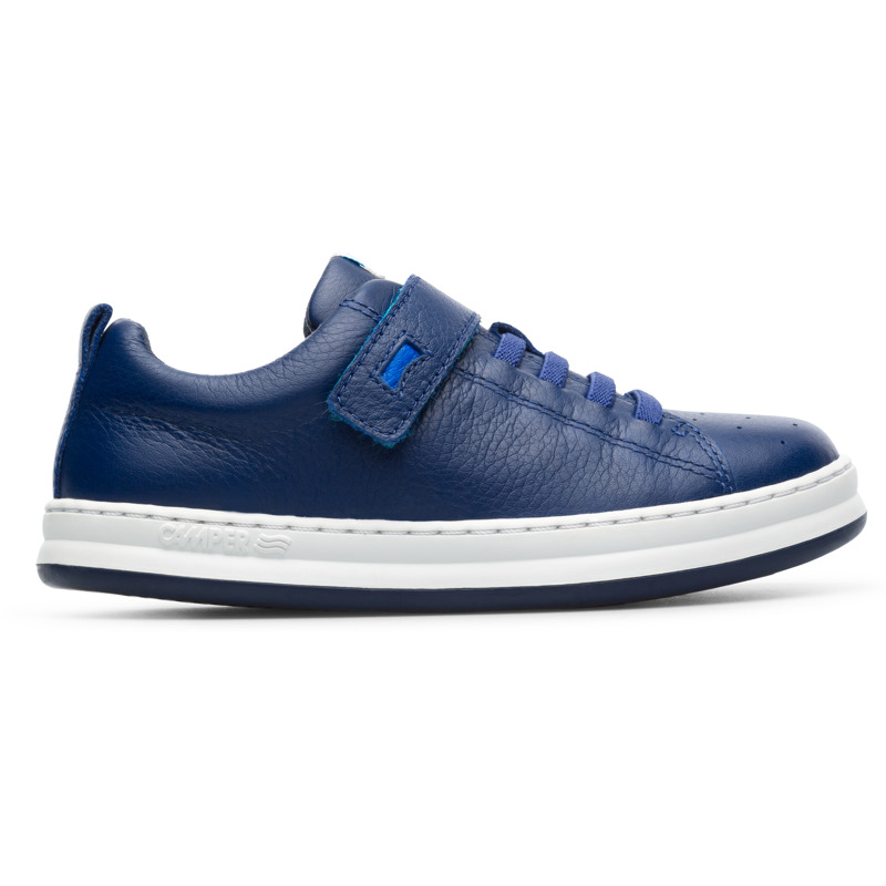 Camper Runner, Sneakers Kids, Blue , Size 25 (US), K800247-005 - Upper: Leather (Calfskin) Color: Navy Outsole/Features: Stitched rubber outsole for durability and good grip Velcro straps for easy fit Insole: OrthoLite for cushioning Lining: 67% Fabric (60% Nylon - 40% PU) 33% Fabric (100% Recycled PET) Leather Working Group Certified - Navy full-grain leather kids sneaker with stitched rubber outsole. Our Runner boys\\\' sneakers are a miniature version of our original sport style. A fun, laid-back look that\\\'s great for all-day play.
