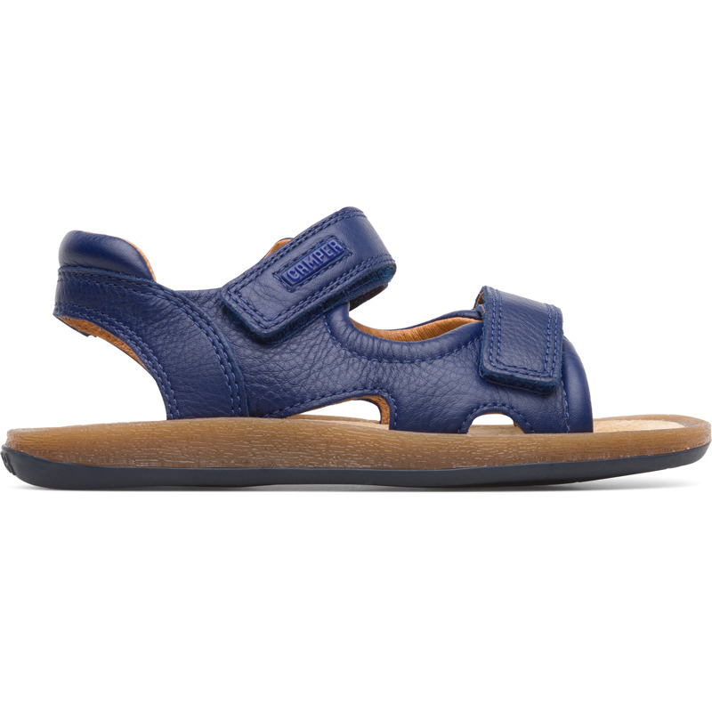 Camper Bicho, Sandals Kids, Blue , Size 25 (US), K800333-001 - Upper: Leather (Calfskin) Color: Blue Outsole/Features: EVA for lightweight Velcro closing system for easy fit Insole: Anatomic and ergonomic last for comfort Lining: 100% Pigskin Leather Working Group Certified - Blue full-grain sandal for kids with Velcro closing and EVA outsole. Our Bicho boys\\\' sandals offer an adjustable design and an ergonomic footbed made of rubber and recycled rice husks for natural movement.