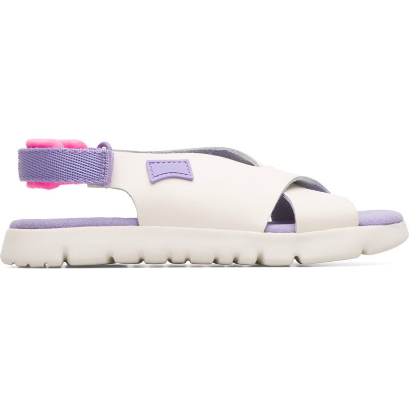 Camper Oruga, Sandals Kids, Beige , Size 25 (US), K800345-002 - Upper: Leather (Calfskin) / Technical fabric (Nylon) Color: Violet / Silver Outsole/Features: EVA with flex-cuts and extraordinary light Elastic straps for easy fit Insole: Padded for cushioning Lining: 56% Calfskin 39% Fabric (60% Nylon - 40% PU) 5% Fabric (60% Polyester - 35% Nylon - 5% Spandex) Leather Working Group Certified - Beige and violet x-strap sandal for kids. Full-grain leather and EVA outsole with flex-cuts. The light and bendable Oruga combines Camper\\\'s distinctive urban style with soft leathers and textiles.