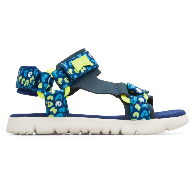 Camper Oruga, Sandals Kids, Blue/Yellow/White, Size 25 (US), K800346-001 - Upper: Technical fabric (100% Recycled PET with print finish) /Leather (Calfskin) / Technical fabric (Nylon) Color: Blue / Multicolor Outsole/Features: EVA with flex-cuts and extraordinary light Velcro closing system for easy fit Insole: Padded for cushioning Lining: 55% Fabric (60% Nylon - 40% PU) 35% Calfskin 7% Fabric (60% Polyester - 35% Nylon - 5% Spandex) 3% Fabric print finished Leather Working Group Certified - Blue sandal for kids with multi-colored details. Full-grain leather and EVA outsole. The light and bendable Oruga combines Camper\\\'s distinctive urban style with soft leathers and textiles.