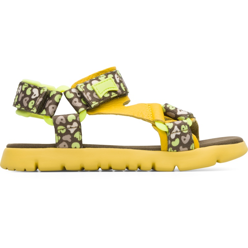 Camper Oruga, Sandals Kids, Yellow/Green/Beige, Size 25 (US), K800346-002 - Upper: Technical fabric (100% Recycled PET with print finish) /Leather (Calfskin) / Technical fabric (Nylon) Color: Yellow / Multicolor Outsole/Features: EVA with flex-cuts and extraordinary light Velcro closing system for easy fit Insole: Padded for cushioning Lining: 55% Fabric (60% Nylon - 40% PU) 35% Calfskin 7% Fabric (60% Polyester - 35% Nylon - 5% Spandex) 3% Fabric print finished Leather Working Group Certified - Yellow sandal for kids with multi-colored details. Full-grain leather and EVA outsole. The light and bendable Oruga combines Camper\\\'s distinctive urban style with soft leathers and textiles.