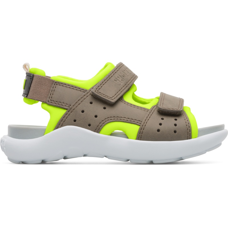 Camper Wous, Sandals Kids, Grey/Yellow, Size 25 (US), K800361-001 - Upper: Leather (Calfskin) / Technical fabric (Nylon) Color: Neon yellow / Beige Outsole/Features: Rubber for good grip Velcro straps for easy fit Waterfriendly for easy cleaning Insole: Anatomic PU for natural foot-shape fit Lining: 50% PU 48% Fabric (60% Polyester - 35% Nylon - 5% Spandex) 2% Fabric (60% Nylon - 40% Rubber) Leather Working Group Certified - Kids multi-colored sandal with Velcro straps and rubber outsole. Brown and yellow details. Designed for both land and water activities, Wous is made from protective leather and boasts a unique design for every summer endeavor.