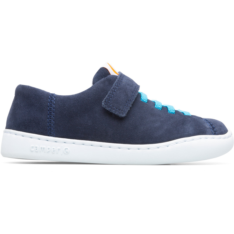 Camper Peu, Sneakers Kids, Blue , Size 25 (US), K800375-002 - Upper: Nubuck Color: Navy Outsole/Features: Rubber for good grip Elastic laces and strap closing system for easy fit Insole: OrthoLite for cushioning Lining: 72% Fabric (100% Recycled PET) 24% Polyester 4% Fabric (60% PU resin - 40% Spandex) Leather Working Group Certified - Navy kids nubuck leather shoe with stitched outsole. Peu Touring is a sportier and more contemporary version of our iconic Peu, enhanced with technical upgrades and a recognizable curve on the outsole.